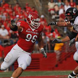 Sep 7, 2009; Piscataway, NJ, USA; Rutgers defensive tackle Charlie Noonan (96) battles linemen during the first half of Rutgers' 47-15 loss to Cincinnati in NCAA college football at Rutgers Stadium.