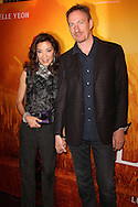 "PARIS, FRANCE - NOVEMBER 22: Michelle Yeoh and David Thewlis attend ""The Lady"" Premiere at the Gaumont Capucines Theater on November 22, 2011 in Paris.(Photo by Tony Barson/BARSONIMAGES)"