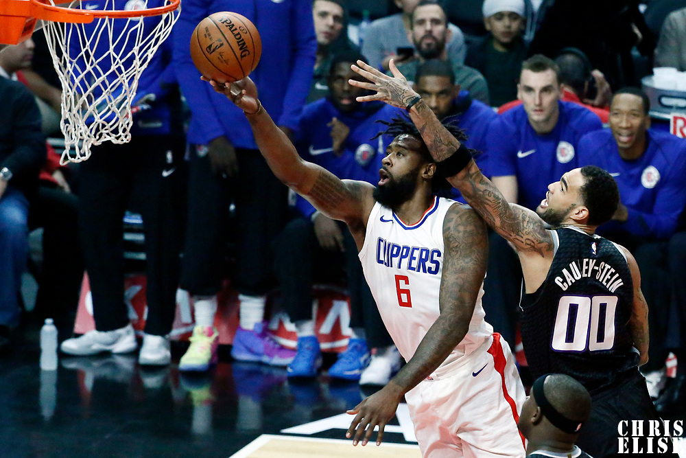 26 December 2017: LA Clippers center DeAndre Jordan (6) goes for the layup past Sacramento Kings center Willie Cauley-Stein (00) during the LA Clippers 122-95 victory over the Sacramento Kings, at the Staples Center, Los Angeles, California, USA.
