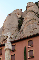 The serrated mountains of the Montserrat massif tower over the Benedictine monastery of the same name, on the outskirts of Barcelona, Spain
