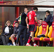 28th April 2018, Fir Park, Motherwell, Scotland; Scottish Premier League football, Motherwell versus Dundee; Sofien Moussa of Dundee is comforted by Dundee manager Neil McCann after going off injured in the third minute of the match