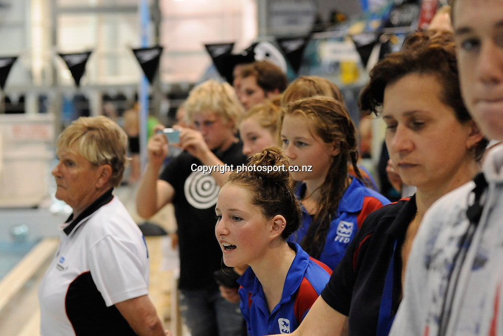 Spectators look on, at the State New Zealand Division II Swimming Champs, at Moana pool, Dunedin, New Zealand. Friday13 April 2012. Photo: Richard Hood photosport.co.nz