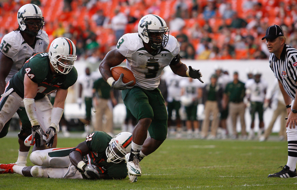 MIAMI GARDENS, FL - NOVEMBER 27: Moise Plancher #3 in action during the game against the Miami Hurricanes at Sun Life Stadium in Miami Gardens, Florida on November 27, 2010. South Florida defeated the Hurricanes 23-20.