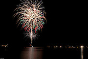 """Jul 4, 2009: 20th Anniversary of the """"Set the Night to Music"""" Fireworks display over Mirror Lake in Lake Placid, N.Y.  (Photo/Todd Bissonette - www.rtbphoto.com)"""