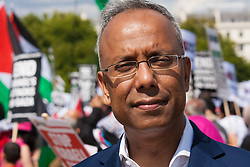 London, August 9th 2014. Tower Hamlets Mayor Lutfur Rahman prepares to address the vast crowd of Palestinians and their supporters during the rally at the end of the march from the BBC via the US embassy, in Hyde Park.