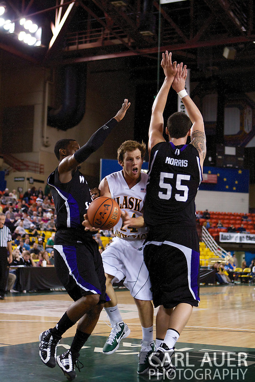 November 25th, 2010:  Anchorage, Alaska - University of Alaska-Anchorage guard Steve White (14) drops a pass in the lane in the Seawolves 54-86 loss to Weber State in the first round of the Great Alaska Shootout.