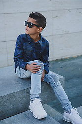 """Cristiano Ronaldo's seven-year-old son is a chip off the old block as they both model matching double denim looks in a campaign for the footballer's denim line. The duo are seen rocking creations from the Spring/Summer 2018 CR7 Limitless and CR7 Junior lines. The 32-year-old Real Madrid player and his son Cristiano Ronaldo Jr, who is understood to have been born via a surrogate mother, pose up a storm in a series of denim looks, and the youngster also steps into the spotlight for some solo shots too. This is not the first time Cristiano Jr has teamed up with his dad to promote the CR7 line. Ronaldo previously explained: """"For me, the CR7 Junior collection is all about having fun and being free, being creative and confident. """"The stretch denim we have used in the collection is extremely comfortable due to the technical elements in the fabric, which will allow boys torun around and be active, move freely and most importantly, play."""" Ronaldo is also father to nine-month-old surrogate twins Mateo and Eva Maria and his girlfriend Georgina Rodriguez gave birth to his fourth child, daughter Alana, in November 2017. 10 Mar 2018 Pictured: Cristiano Ronaldo and his son Cristiano Ronaldo Jr pose in clothes from the footballer's CR7 Limitless and CR7 Junior Spring/Summer 2018 lines. Photo credit: CR7/ MEGA TheMegaAgency.com +1 888 505 6342"""
