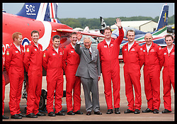 Image licensed to i-Images Picture Agency. 11/07/2014. Windsor, United Kingdom. The Prince of Wales meets Red Arrows pilots as part of their 50th anniversary display season at the Royal International Air Tattoo at RAF Fairford, Gloucestershire,  United Kingdom. Picture by Stephen Lock / i-Images