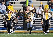 September 22 2012: Iowa Hawkeyes Golden Girl Whittney Seckar-Anderson takes the field with the Hawkeye Marching Band before the start of the NCAA football game between the Central Michigan Chippewas and the Iowa Hawkeyes at Kinnick Stadium in Iowa City, Iowa on Saturday September 22, 2012. Central Michigan defeated Iowa 32-31.