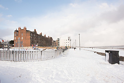 It doesn't happen very often but this morning there was a thick blanket of snow on Portobello beach. Beach volleyball pair Mel Coutts and Lynne Beattie must be delighted to be in Fort Lauderdale for their Commonwealth Games preparation and not training on their usual court!<br /> <br /> <br /> &copy; Jon Davey/ EEm