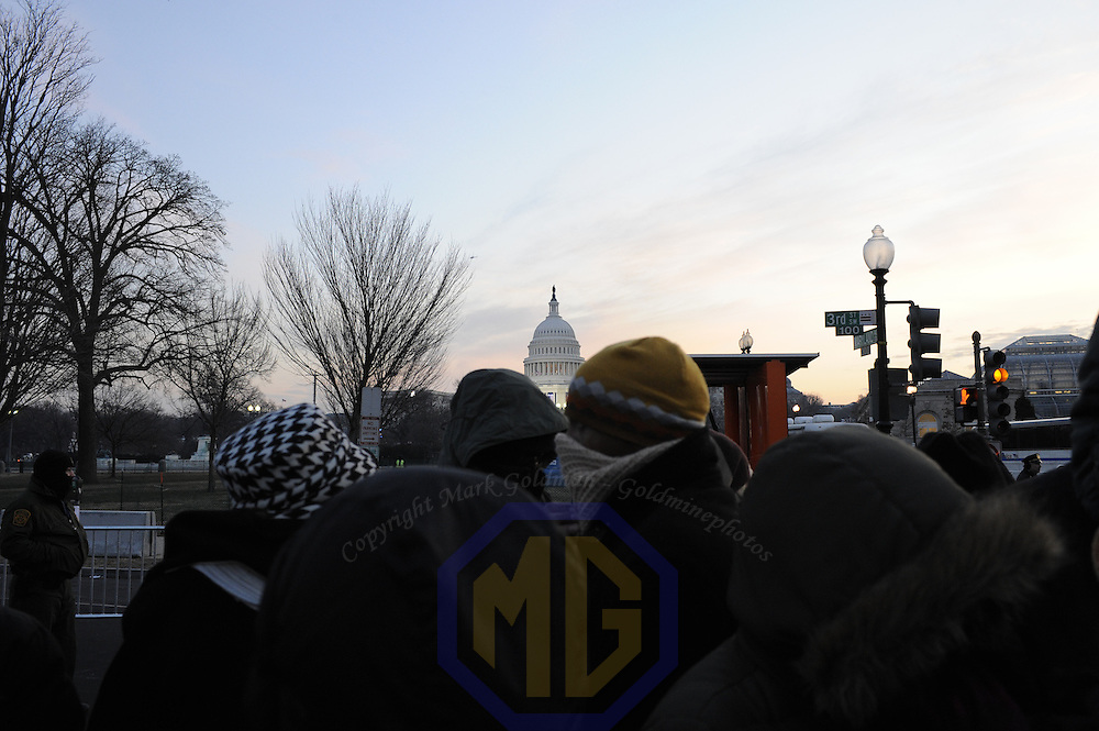 A large crowd gathers to gain entrance through one of the checkpoints  with the U.S. Capital in the background at 7:25 AM for the swearing in of Barack Obama as the 44th President of the United States of America during his Inauguration Ceremony on Capitol Hill in Washington on January 20, 2009.    (Mark Goldman/ Goldmine Photos)