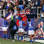 Despite Samoa's losses to South Africa (0-14) and Canada (19-22), Manu Samoa was clearly the most popular team with their commited loyal fans on their farewell lap.  The third and final day of action, inwhich South Africa was crowned champions at the USA Sevens, Sam Boyd Stadium, Las Vegas, Nevada.  Photo by Barry Markowitz, Courtesy STP/TriMarine, 1/26/14, 4pm
