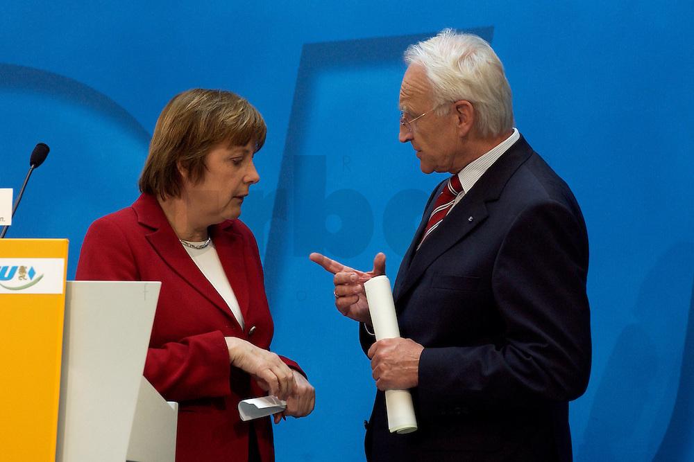 02 APR 2004, BERLIN/GERMANY:<br /> Angela Merkel (L), CDU Bundesvorsitzende, und Edmund Stoiber (R), CSU, Ministerpraesident Bayern, im Gespraech, nach einem Pressestatement zu dem vorangegangenem europapolitischen Spitzengespraech von CDU und CSU, Konrad-Adenauer-Haus<br /> IMAGE: 20040402-02-019<br /> KEYWORDS: Ministerpr&auml;sident, CDU Bundesgeschaeftsstelle, Gespr&auml;ch