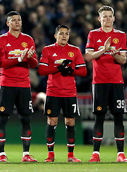 """Manchester United's Alexis Sanchez (centre) stands for a minute's applause for Jimmy Armfield, who died this week, before the Emirates FA Cup, fourth round match at Huish Park, Yeovil. PRESS ASSOCIATION Photo. Picture date: Friday January 26, 2018. See PA story SOCCER Yeovil. Photo credit should read: Nick Potts/PA Wire. RESTRICTIONS: EDITORIAL USE ONLY No use with unauthorised audio, video, data, fixture lists, club/league logos or """"live"""" services. Online in-match use limited to 75 images, no video emulation. No use in betting, games or single club/league/player publications."""