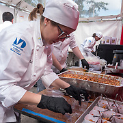 FEBRUARY 10, 2018---MIAMI, FLORIDA<br /> Miami Culinary Institute students from MDC help prepare food as part of Miami based artist Antoni Miralda's event, The Maggic Banquet, a multifaceted participatory project centered on food  at EXILE Books in Little Haiti.<br /> (PHOTO BY ANGEL VALENTIN for MDC