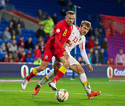 CARDIFF, WALES - Friday, October 11, 2013: Wales' Craig Bellamy in action against Macedonia's Stefan Ristovski during the 2014 FIFA World Cup Brazil Qualifying Group A match at the Cardiff City Stadium. (Pic by David Rawcliffe/Propaganda)