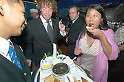 Captain Choinski's Welcome Reception aboard the Sea Cloud..Caviar for all! Michael tesone and Miss Lee.