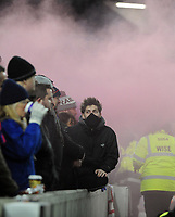 Football - 2017 / 2018 Premier League - Brighton & Hove Albion vs. Crystal Palace<br /> <br /> Palace fans cover their faces as fireworks are set off in the crowd, at The Amex.<br /> <br /> COLORSPORT/ANDREW COWIE