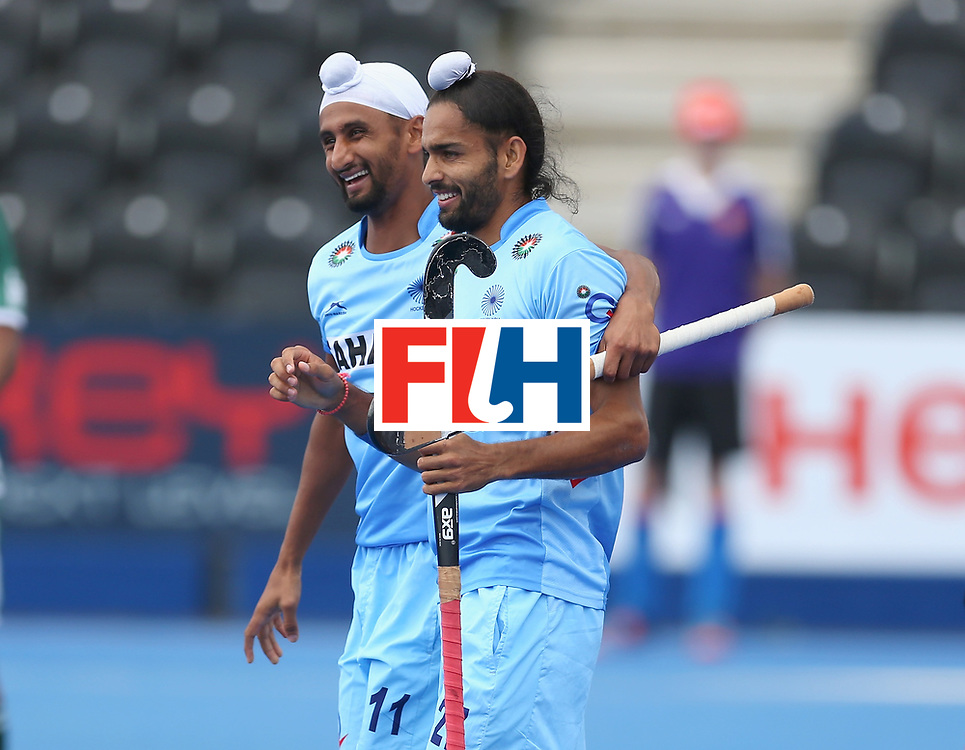 LONDON, ENGLAND - JUNE 24:  Akashdeep Singh of India celebrates with teammate Mandeep Singhl during the 5th-8th place match between Pakistan and India on day eight of the Hero Hockey World League Semi-Final at Lee Valley Hockey and Tennis Centre on June 24, 2017 in London, England.  (Photo by Steve Bardens/Getty Images)