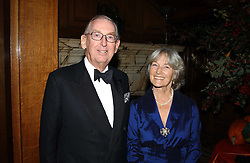 LORD & LADY SAINSBURY OF PRESTON CANDOVER at a recital and dinner to celebrate the 10th anniversary of The Galitzine Library held at 2 Temple Place, London WC2 on 16th November 2004.<br />