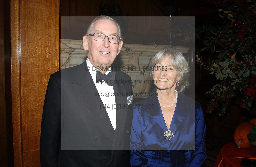 LORD &amp; LADY SAINSBURY OF PRESTON CANDOVER at a recital and dinner to celebrate the 10th anniversary of The Galitzine Library held at 2 Temple Place, London WC2 on 16th November 2004.<br />