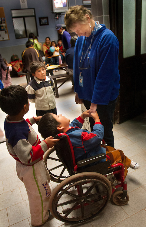 Sandra del Prado, co-founder of the Kausay Wasi Clinica in Coya, greets a young boy who had a club foot corrected the year before by Dr. Shaw's team. del Prado was the first Peace Corps volunteer to come to Peru, where she met her husband and cofounder, Guido, a former US Foreign Service agent.Oregon orthopedic doctors and support staff helped hundreds of Peruvian children in Coya, Peru performing corrective surgeries and therapy to improve their quality of life.