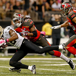 Oct 5, 2014; New Orleans, LA, USA; New Orleans Saints wide receiver Marques Colston (12) catches a pass ahead of Tampa Bay Buccaneers strong safety Mark Barron (23) during the first quarter of a game at Mercedes-Benz Superdome. Mandatory Credit: Derick E. Hingle-USA TODAY Sports