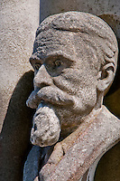 Stone bust of a man with a beard on a grave on Isola San Michel, Venice, Italy.