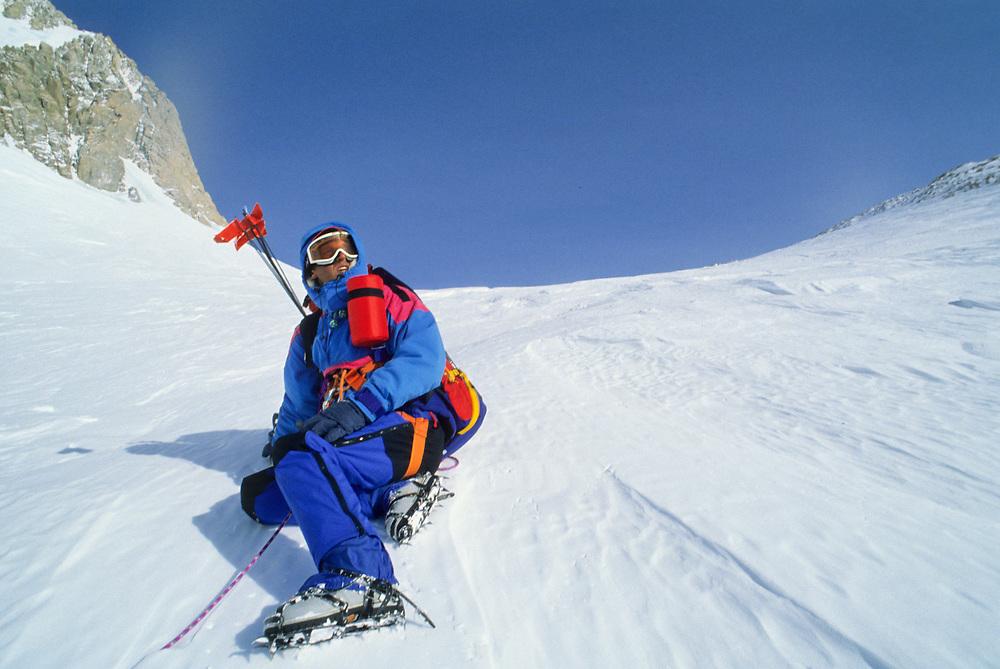 Alaska. Denali NP. German climber woman rests at windy corner (13200) on Denali.