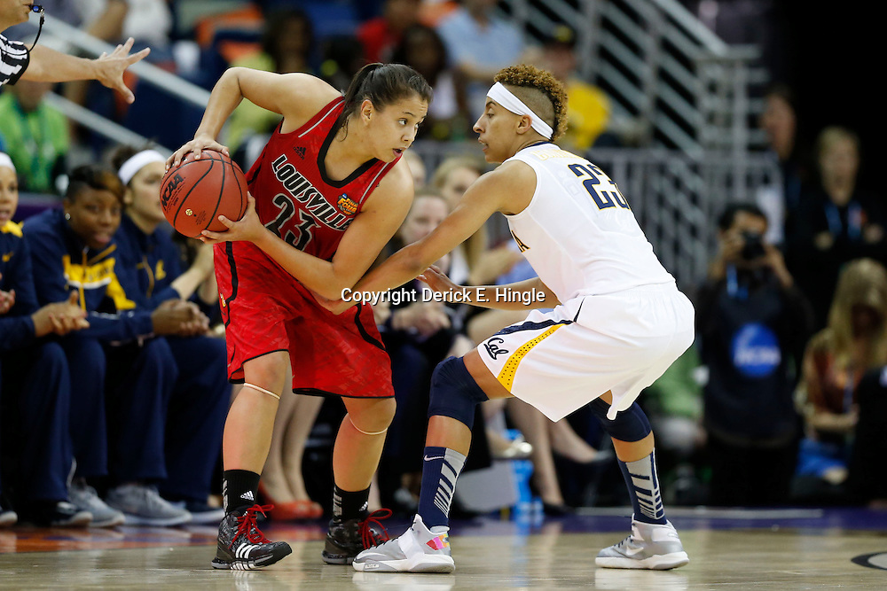 April 7, 2013; New Orleans, LA, USA; Louisville Cardinals guard Shoni Schimmel (23, left) controls the ball against California Golden Bears guard Layshia Clarendon (23, right) during the first half in the semifinals during the 2013 NCAA womens Final Four at the New Orleans Arena. Mandatory Credit: Derick E. Hingle-USA TODAY Sports