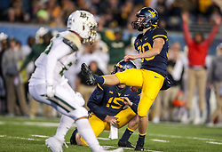 Oct 25, 2018; Morgantown, WV, USA; West Virginia Mountaineers place kicker Evan Staley (30) kicks a field goal during the first quarter against the Baylor Bears at Mountaineer Field at Milan Puskar Stadium. Mandatory Credit: Ben Queen-USA TODAY Sports