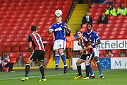 Ipswich Town forward Martyn Waghorn (9) gets to ball before Sheffield United striker Billy Sharp (10) and Sheffield United defender Enda Stevens (3) during the EFL Sky Bet Championship match between Sheffield Utd and Ipswich Town at Bramall Lane, Sheffield, England on 14 October 2017. Photo by Ian Lyall.