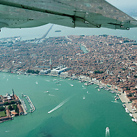 VENICE, ITALY - JULY 07:   An aerial view of Venice and San Giorgio Island seen during the Seawing  tour above Venice on July 7, 2011 in Venice, Italy. Seawings has started a new tour of Venice by seaplane, offering aerial views of the Venetian Lagoon and its historic islands, continuing a long history of seaplanes in Venice.