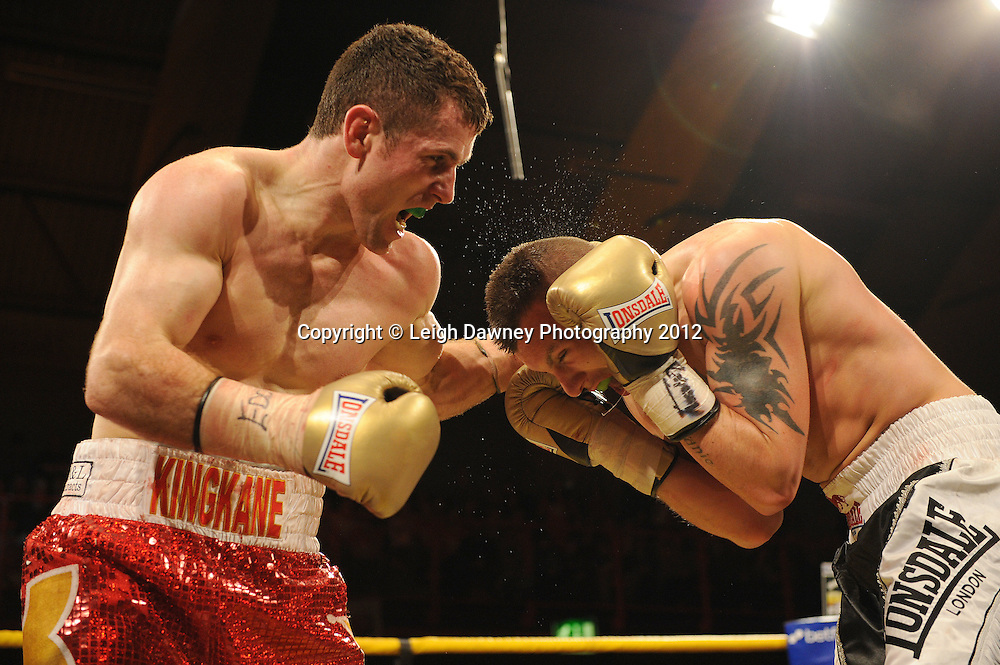 Eamonn O'Kane (red shorts) defeats JJ McDonagh to claim Prizefighter Irish Middleweights at Kings Hall, Belfast, Northern Ireland on 5th May 2012. Promoted by Prizefighter/Matchroom Sport. © Leigh Dawney Photography 2012.