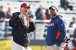 November 20, 2010; Chestnut Hill, MA, USA;  Boston College Eagles head coach Frank Spaziani (left) talks with Virginia Cavaliers head coach Mike London (right) before the game at Alumni Stadium.