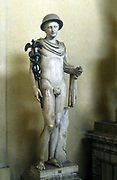 Hermes, Greek god (Mercury in Roman pantheon) messenger of the gods, god of roads and travellers, holding his caduceus or herald's staff. Marble statue.