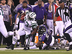 Sept 13, 2011; East Rutherford, NJ, USA; New York Jets running back Shonn Greene (23) is horse collared by Baltimore Ravens linebacker Jameel McClain (53) during the first half at the New Meadowlands Stadium.