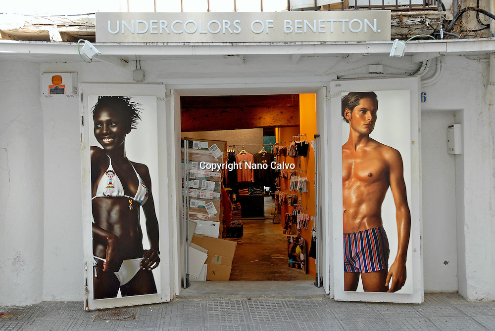 Models photographs in the United Colors of Benetton shop in the port area of Ibiza