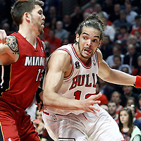 18 May 2011: Chicago Bulls center Joakim Noah (13) drives past Miami Heat shooting guard Mike Miller (13) during the Miami Heat 85-75 victory over the Chicago Bulls, during game 2 of the Eastern Conference finals at the United Center, Chicago, Illinois, USA.