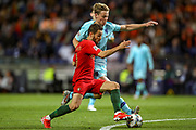 Portugal midfielder Bernardo Silva (10) battles with Netherlands Midfielder Frenkie de Jong (Ajax) during the UEFA Nations League match between Portugal and Netherlands at Estadio do Dragao, Porto, Portugal on 9 June 2019.