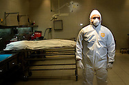 Hector Hawley Morelos, Director of the Crime Investigation Center in Juarez posing for a portrait in the morgue, Friday, April 3, 2009.