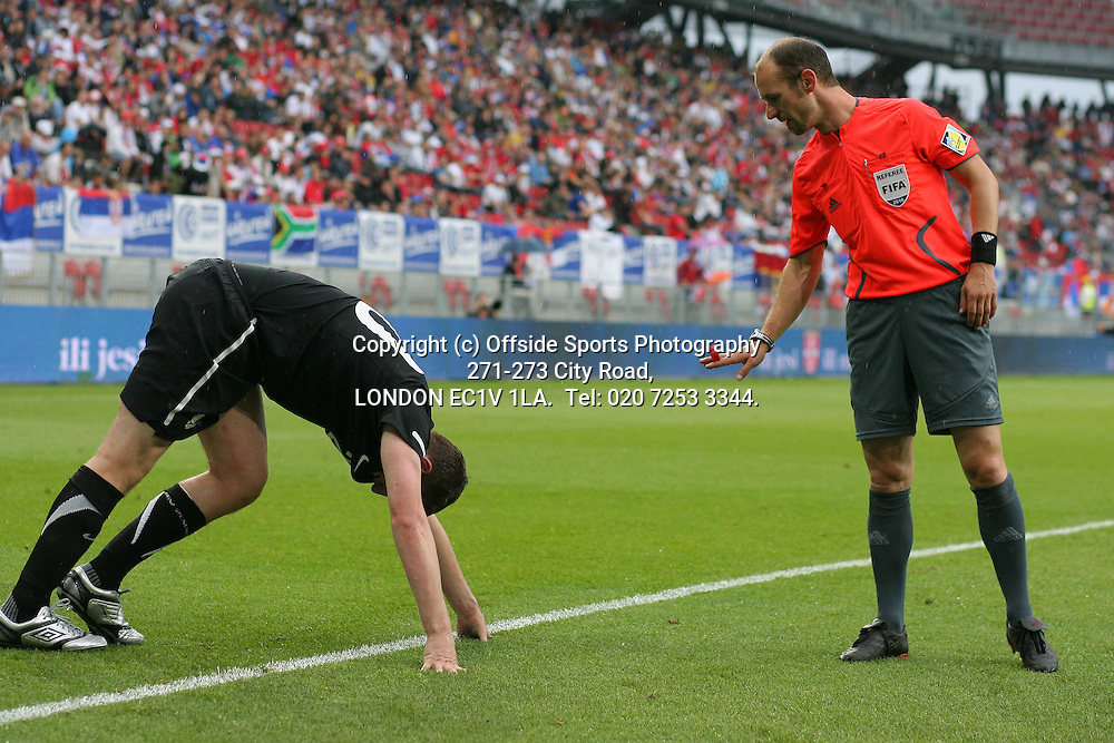 29/05/2010 International football. Serbia v New Zealand.<br /> The referee checks on the wellbeing of Chris Wood.<br /> Photo: Mark Leech.