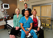 Crystal Kasnoff (cq), (clockwise from left), and Thomas V. Thaller, both of M & I; Michelle Ziemba, director of Trauma Services at UMC; and Peter M. Rhee, M.D., Director, Division of Trauma, Critical Care & Emergency Surgery at UMC.
