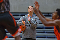 UPike Men's head basketball coach Kelly Wells, right, cheers on the team during a drill at team workouts, Wednesday, Sept. 24, 2014 at the Eastern Kentucky Expo Center in Pikeville. <br /> <br /> Photo by Jonathan Palmer, Special to the CJ