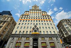 THEMENBILD - Madrid ist seit Jahrhunderten der geographische, politische und kulturelle Mittelpunkt Spaniens (siehe Kastilien) und der Sitz der spanischen Regierung. Hier residieren auch der König, ein katholischer Erzbischof sowie wichtige Verwaltungs- und Militärbehörden. Als Handels- und Finanzzentrum hat die Stadt nationale und internationale Bedeutung. Hier im Bild royale Beflaggung des Edificio Telef??nica, erstes Hochhaus Europas, Prachtstrasse Calle Gran Via // THEMATIC PACKAGES - Madrid is the capital and largest city of Spain. The population of the city is roughly 3.3 million and the entire population of the Madrid metropolitan area is calculated to be around 6.5 million. It is the third-largest city in the European Union, after London and Berlin, and its metropolitan area is the third-largest in the European Union after London and Paris. The city spans a total of 604.3 km2. EXPA Pictures © 2014, PhotoCredit: EXPA/ Eibner-Pressefoto/ Weber<br /> <br /> *****ATTENTION - OUT of GER*****