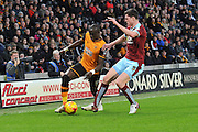 Hull City midfielder Mohammed Diame and Burnley defender Michael Keane during the Sky Bet Championship match between Hull City and Burnley at the KC Stadium, Kingston upon Hull, England on 26 December 2015. Photo by Ian Lyall.