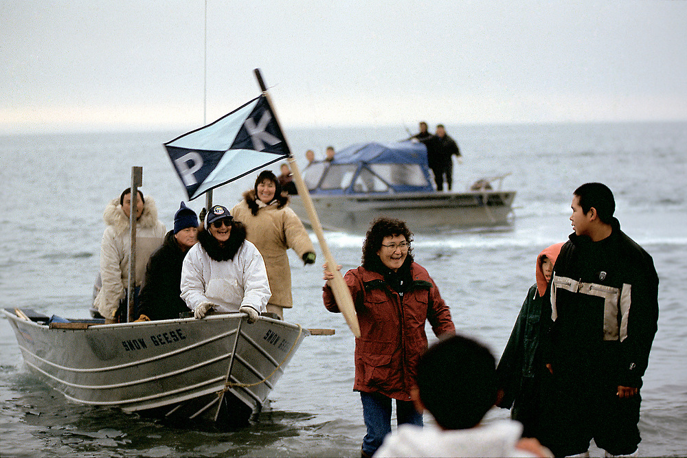 Alaska . Barrow . Whaling crew returning from hunt.