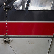 An abstract detail of the pilot door on a Dehaviland Beaver on the shore of Hood Lake airstrip in Anchorage, Alaska.