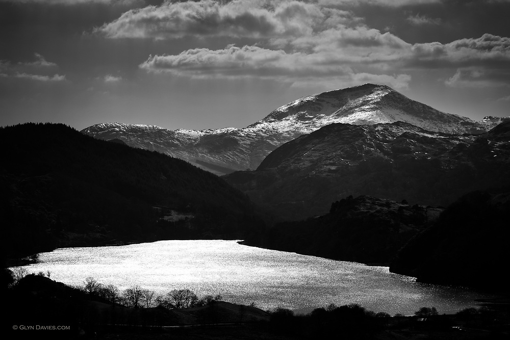 Crisp sunlight over a frozen landscape in the heart of Snowdonia. Llyn Gwynant sparkles in the foreground.