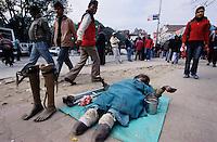 Ratna Park, 08 February 2005.  A beggar in the street of Kathmandu